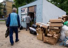 People are handing over junk in recycling center, Voronezh stock photos