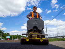 Trimming the asphalt with a vibrating machine. Voronezh, Russia - June 04, 2017: Trimming the asphalt with a vibrating machine Stock Image