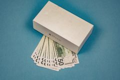 Voronezh Russia - may 3, 2019. Apple Inc. logo and fifty dollar bills on the blue background stock image