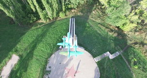 Voronezh, Russia, Monument to airplane of the Second World War. Rural landscape. Aerial stock video footage