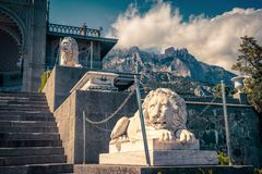 Vorontsov Palace with lion statues on mountain background in Crimea, Russia. Crimea - May 20, 2016: Vorontsov Palace with lion statues on mountain background in royalty free stock photos