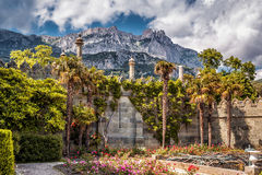 Vorontsov Palace on the mountain background, Crimea. ALUPKA, CRIMEA - MAY 20, 2016: The garden in the Vorontsov Palace. Mountain Ai-Petri in the distance. This stock image