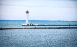 Vorontsovsky lighthouse near a pier in Odessa port Stock Image