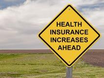 Vorsicht - Krankenversicherung erhöht sich voran Stockfotos