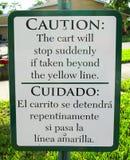 Vorsicht-Zeichen-Englisch u. Spanisch Lizenzfreies Stockfoto