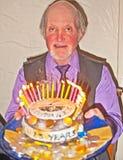 Vorsitzender mit Jahrestagskuchen Stockfoto