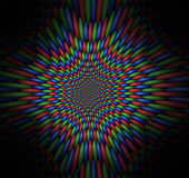 Vortex of vibrating red, green and blue spheres Royalty Free Stock Images