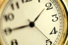 Vorwahlknopf der Uhr Stockfoto