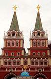 Voskresensky gates on Red Square, Moscow(Russia). Voskresensky gates is the main entrance to Red Square, Moscow(Russia). The gate is a ornate building situated Stock Photos