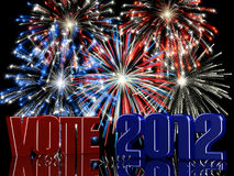 Vote 2012 Fireworks. Fireworks displayed behind a 3D VOTE 2012 with reflections Royalty Free Stock Image