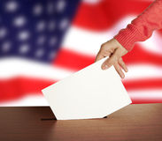 Vote. Hand with ballot and box on Flag of USA Royalty Free Stock Photo