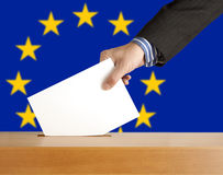 Vote. Hand with ballot and box on Flag of Europe Stock Images