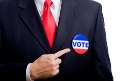 VOTE. A vote button on a politician or a business man with a blue suit stock photos