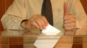 Vote. Hand putting a blank ballot inside the box, elections concept Royalty Free Stock Photo