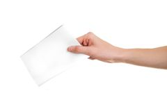 Vote!. Hand with ballot on white background Royalty Free Stock Photography