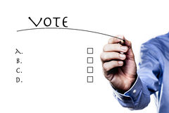 The Vote ABCD. Picture of hand holding a pencil isolated on white background Royalty Free Stock Photo
