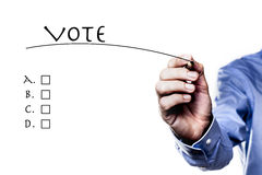 The Vote ABCD. Picture of hand holding a pencil isolated on white background Stock Image
