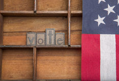 Vote  with American Flag. Wooden letters saying Vote  with an American flag Royalty Free Stock Photography
