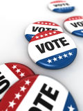 Vote badgets. 6 vote badgets on a white table Stock Photography
