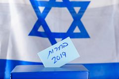 Vote box. Hebrew text Elections 2019 on voting paper. stock photos