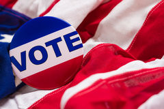 Vote button on an American flag Royalty Free Stock Image