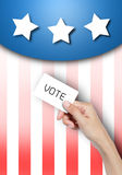 Vote card in hand. Hand holding vote card over USA flag background Stock Images