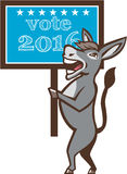Vote 2016 Democrat Donkey Mascot Cartoon. Illustration of a democrat donkey mascot of the democratic grand old party gop smiling holding a sign placard with Vote Stock Photography