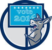 Vote 2016 Democrat Donkey Mascot Circle Cartoon. Illustration of a democrat donkey mascot of the democratic grand old party gop smiling holding a sign placard Stock Images