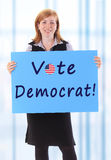 Vote democrat. Young beauty business woman hold paper vote democrat text on it royalty free stock images