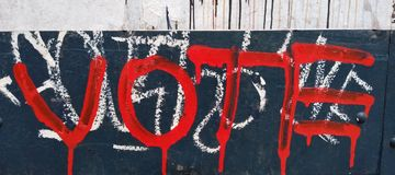 Vote, Dripping Red Graffiti. Vote red dripping graffiti vandalism drips blue punk grunge edgy hard core votes voting voters political politics activism election royalty free stock photos
