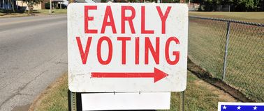 Vote Early Sign. An early voting sign pointing towards a location where people can vote early for an election Royalty Free Stock Photo