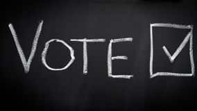 Vote in election. Vote word in election on blackboard royalty free stock images