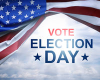 Vote Election Day written on under the USA flag. With cloud sky background Royalty Free Stock Image