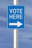 Vote Here. Modified one way road sign indicating Vote Here Royalty Free Stock Photos