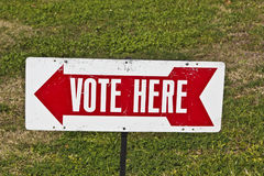 Vote Here Sign. Voting signs outside community polling place during primary Royalty Free Stock Photos