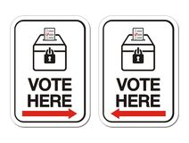 Vote here sign with arrow Royalty Free Stock Photography