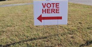 Vote Here Sign. An vote here sign pointing towards a location where people can vote in an election Stock Images