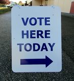 Vote here today sign royalty free stock photo