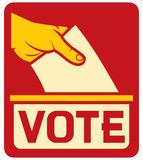 Vote label. Hand putting a voting ballot in a slot of box Royalty Free Stock Photo