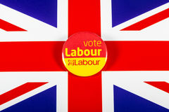 Vote Labour Pin Badge. LONDON, UK - MAY 2ND 2017: A Vote Labour political pin badge over the UK flag, on 2nd May 2017 Royalty Free Stock Photo