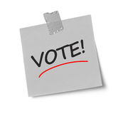 Vote message on adhesive note royalty free stock image