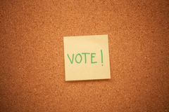 Vote note on cork board Stock Images
