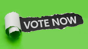 Vote now. Torn green paper revealing the words Vote now Royalty Free Stock Photo