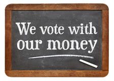 We vote with our money blackboard sign Stock Photos