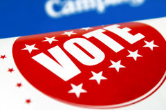 Vote!. Red Vote sticker printed in a political newspaper stock photos