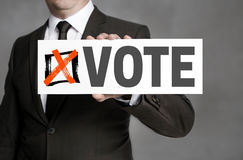 Vote sign is held by businessman Stock Photo