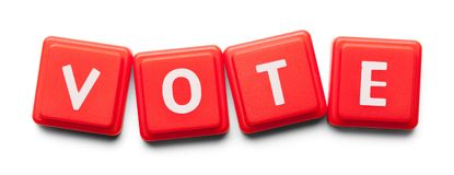 Vote Plastic Tiles. Vote Spelled with Wood Tiles Isolated on a White Background Stock Photo