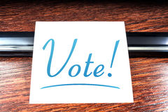 Vote Sticky Note On Paper Lying On Wooden Cupboard Royalty Free Stock Photo
