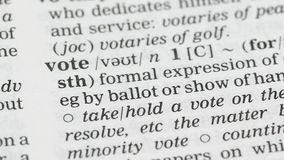 Vote, word definition on english vocabulary page, presidential election, freedom stock footage