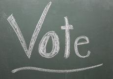 Vote Written on Blackboard Stock Photo
